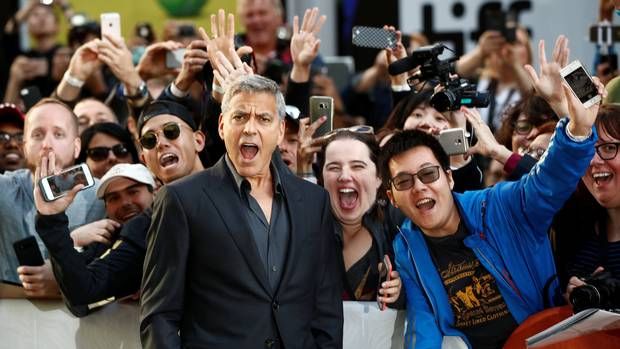 George Clooney gets into the festival spirit ahead of a premiere for Suburbicon at the Toronto International Film Festival in Toronto on Sept. 9, 2017.