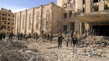 Syrian security inspect the site of an explosion in Syria's northern city of Aleppo February 10, 2012. Twin bomb blasts hit Syrian military and security buildings in Aleppo on Friday, killing 25 people in the worst violence to hit the country's commercial hub in the 11-month uprising against President Bashar al-Assad. (SANA/REUTERS)