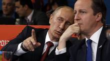 Russian President Vladmir Putin, left and British Prime Minister David Cameron watch the judo during the women's 78-kg judo competition at the 2012 Summer Olympics, Thursday, Aug. 2, 2012, in London. (Paul Sancya/AP)