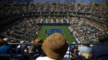 Spectators watch play between Lleyton Hewitt, of Australia, and Tomas Berdych, of the Czech Republic, during the second round of the 2014 U.S. Open tennis tournament, Wednesday, Aug. 27, 2014, in New York. (Matt Rourke/AP)