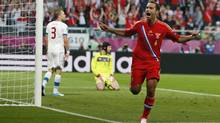 Russia's Roman Shirokov celebrates after he scored in front of Czech goalkeeper Petr Cech and player Michal Kadlec during the Euro 2012 soccer championship Group A match between Russia and Czech Republic in Wroclaw, Poland, Friday, June 8, 2012. (Associated Press)