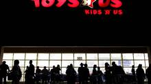 In this Nov. 25, 2010, file photo, people lineup outside Toys R Us as Black Friday sales begin, in Royal Palm Beach, Fla. (Rachel Mummey/Associated Press/The Palm Beach Post)