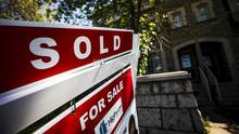 """A """"For Sale"""" sign stands in front of a home that has been sold in Toronto, Canada, June 29, 2015. REUTERS/Mark Blinch (Mark Blinch/Reuters)"""