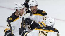 Boston Bruins' Jarome Iginla (12) celebrates with teammates David Krejci, left, and Torey Krug after scoring against the Montreal Canadiens during first period NHL preseason action in Montreal, Monday, September 16, 2013. (Graham Hughes/THE CANADIAN PRESS)