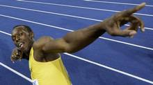 Jamaica's Usain Bolt celebrates setting a new 100m World Record after the final of the Men's 100m during the World Athletics Championships in Berlin on Sunday, Aug. 16, 2009. (AP Photo/David J. Phillip) (David J. Phillip/AP)