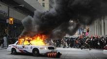 Anti-summit protesters clash with police in downtown Toronto, Ont June 25/2010. (Kevin Van Paassen/The Globe and Mail/Kevin Van Paassen/The Globe and Mail)