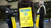 LifeLabs unionized staff and medical laboratory workers strike outside the LifeLabs 750 West Broadway location in Vancouver on Jan. 21, 2013. Rafal Gerszak for The Globe and Mail (Rafal Gerszak for The Globe and Mail)