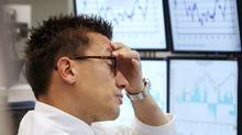 A trader watches his screens at the stock market in Frankfurt, Germany, Thursday, Sept. 22 2011, when the stock index DAX lost about four per cent. (Michael Probst/Michael Probst/AP)