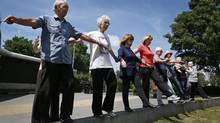 George Jackson, 85, left, says that after taking the parkour class he finds that he has stopped limping when he walks. (Lefteris Pitarakis/Associated Press)