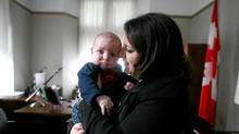 NDP MP Sana Hassainia with her three month old baby Skander-Jack Kochlef in her office on Parliament Hill in Ottawa. (Dave Chan/The Globe and Mail)