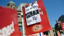 A sign criticizing Ontario's McGuinty government is held by a protester at a rally for public education and democracy organized by the Elementary Teachers' Federation of Ontarioat Queens Park in Toronto on Aug. 28, 2012. (Aaron Vincent Elkaim/THE CANADIAN PRESS)