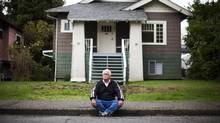 Renter Daryl Morgan sits outside one of the many homes he has been evicted from in Vancouver. (Rafal Gerszak For The Globe and Mail)