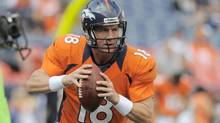 Denver Broncos quarterback Peyton Manning looks to pass during warmups before an NFL preseason game against the Seattle Seahawks, Saturday, Aug. 18, 2012, in Denver. (Jack Dempsey/AP)
