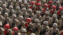 Iranian army troops march in a military parade commemorating the start of the Iraq-Iran war 32 years ago, in front of the mausoleum of the late revolutionary founder Ayatollah Khomeini, just outside Tehran, Iran, Friday, Sept. 21, 2012. (Vahid Salemi/AP)