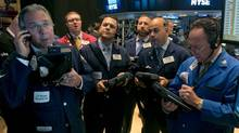 Traders gather at a post on the floor of the New York Stock Exchange Thursday, Aug. 7, 2014. (Richard Drew/AP)