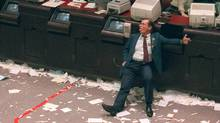 An exhausted trader slumps in his chair at the Toronto Stock Exchange October 19, 1987, known as Black Monday. (Tim Clark/The Canadian Press)
