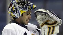 Buffalo Sabres' Ryan Miller looks on during NHL hockey training camp in Buffalo, N.Y., Friday, Sept. 17, 2010. (AP Photo/David Duprey) (David Duprey)