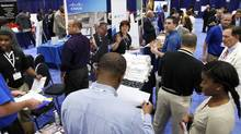 Job seekers talk with recruiters at a Hire Our Heroes job fair in Washington, in this file photo. (JONATHAN ERNST/REUTERS)