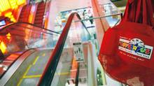 """A Toys """"R"""" Us shopping bag is seen inside their Times Square store in New York. (SHANNON STAPLETON/REUTERS)"""