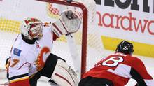 Calgary Flames goaltender Leland Irving (37) watches as Ottawa Senators Zenon Konopka's (28) shot goes over the crossbar during second period NHL hockey action in Ottawa Friday December 30, 2011. THE CANADIAN PRESS/Fred Chartrand (Fred Chartrand/CP)