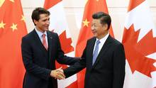 Prime Minister Justin Trudeau shakes hands with Chinese President Xi Jinping during the PM's visit to Beijing in August. (Pool/Getty Images)
