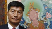 Lobsang Sangay, the new Kalon Tripa, or Tibetan prime minister-in-exile, poses in front of a scroll painting at the International Campaign for Tibet building in Washington April 27, 2011. Tibetan exiles elected the Harvard law scholar as their political leader. The handover of power will give the prime minister's role greater clout as the region seeks autonomy from China and could stave off a possible crisis of leadership in the event of the Dalai Lama's death. Lobsang Sangay, the new Kalon Tripa of Tibet's government-in-exile, says he feels that taking over the political responsibilities of the Dalai Lama is his leh, or karmic destiny. (Kevin Lamarque/Reuters/Kevin Lamarque/Reuters)