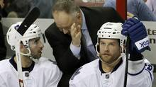Toronto Maple Leafs coach Randy Carlyle talks to Nazem Kadri (3) and Colton Orr (28) during the third period of an NHL hockey game against the Florida Panthers in Sunrise, Fla., Monday, Feb. 18, 2013. (Associated Press)