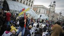 Spaniards demonstrate at the Puerta del Sol square in Madrid last month to protest spending cuts, high unemployment and political corruption. (PEDRO ARMESTRE/PEDRO ARMESTRE/AFP/GETTY IMAGES)