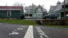The Canada- US border line runs through a home on Lee St. in Stanstead, Quebec. The street is due to have a gate to stop unauthorized border crossing. (Christinne Muschi for The Globe and Mail)
