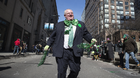 Mayor Rob Ford strides down Toronto's Yonge Street during the St. Patrick's Day parade on Sunday March 16, 2014.