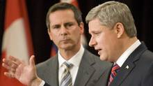 Prime Minister Stephen Harper and Ontario Premier Dalton McGuinty take questions at a Toronto news conference on June 1, 2009. (FRED THORNHILL/REUTERS)