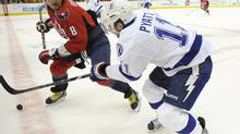 Washington Capitals left wing Alex Ovechkin (8), of Russia, pursues Tampa Bay Lightning center Tom Pyatt (11) during the first period of an NHL hockey game, Sunday, April 7, 2013, in Washington. (Nick Wass/AP)