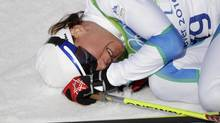 Slovenia's bronze medal winner Petra Majdic sits injured on the ground after a Women's individual classic sprint Cross Country final heat at the Vancouver 2010 Olympics in Whistler, British Columbia, Canada, Wednesday, Feb. 17, 2010. (<72>Elaine Thompson/The Associated Press<252><71>)