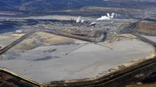 The Suncor tar sands plant and tailings pond at their tar sands operation north of Fort McMurray, Alberta, November 3, 2011. A tailings pond holds all the toxic waste from oil sands extraction process. (TODD KOROL/REUTERS/TODD KOROL/REUTERS)