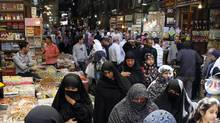 People walk at al-Bzoria market in old Damascus, in this file picture taken April 17, 2012. (KHALED AL-HARIRI/REUTERS)
