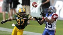 Montreal Alouettes' Brian Bratton (R) catches a touchdown pass against Edmonton Eskimos' Rod Williams during their CFL game in Edmonton August 17, 2012. (DAN RIEDLHUBER/REUTERS)