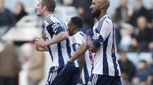 This Saturday Dec. 28, 2013 file photo shows West Bromwich Albion's Nicolas Anelka, right, as he gestures to celebrate his goal against West Ham United during their English Premier League soccer match at Upton Park, London. (Sang Tan/Associated Press)