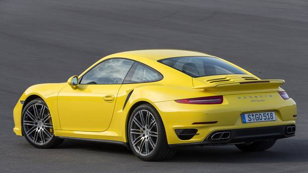 2014 Porsche 911 Turbo: A spoiler lip appears under the bumper on both the front and rear of the vehicle when it travels faster than 120 km/h. (Porsche)