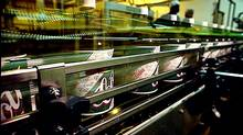 Bottles of Cott ginger ale move down the bottling line a the company's plant in Mississauga