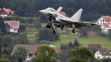 The first of Austria's 15 new Eurofighter Typhoons on the approach to the military airport in the small Styrian village of Zeltweg, July 12, 2007. German prosecutors are investigating European defence company EADS, manufacturer of the Eurofighter, on suspicion of bribery in the Austrian contract. (LEONHARD FOEGER/REUTERS)