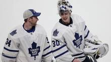Toronto Maple Leafs goaltender Ben Scrivens (R) smiles as he skates off the ice with teammate James Reimer following the win over Montreal Canadiens in Montreal, January 19, 2013. (CHRISTINNE MUSCHI/REUTERS)