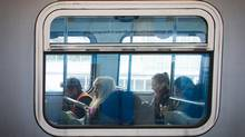 Passengers sit on a Canada Line train in Richmond, B.C., on Feb. 25, 2015. The new board chair of TransLink believes the transit agency will undergo dramatic changes this year with new leaders and new board members. (DARRYL DYCK For The Globe and Mail)