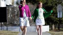 Alberta Premier Alison Redford and her daughter, Sarah, walk to a voting station in Calgary. (TODD KOROL/REUTERS)