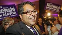 Calgary Mayor Naheed Nenshi celebrates his re-election as mayor at his campaign party in Calgary, Alta., Monday, Oct. 21, 2013. (Jeff McIntosh/THE CANADIAN PRESS)