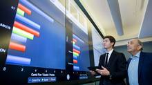 Maple Leafs assistant GM Kyle Dubas and SAS executive vice-president Carl Farrelll crunch some numbers on a giant monitor at SAS headquarters in Toronto (SAS)