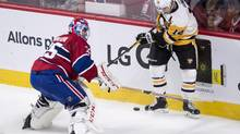 Montreal Canadiens goalie Al Montoya plays for the puck against Pittsburgh Penguins' Chris Kunitz during first period NHL hockey action Tuesday, October 18, 2016 in Montreal. (Paul Chiasson/THE CANADIAN PRESS)