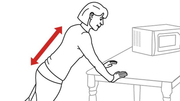 Face the countertop and place your hands on the edge, roughly shoulder-width apart. Step your feet backward. Lift your heels up so that your body forms a plank. Don't let your back round or arch. (Carrie Cockburn/The Globe and Mail)