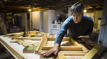 Victoria-based First Nations artist Carey Newman creates in his basement workshop. (John Lehmann/The Globe and Mail)