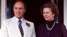 Margaret Thatcher and Pierre Trudeau as shown in Australia in this Oct. 4, 1981 file photo. Ex-spokesman Tim Bell says that former British Prime Minister Margaret Thatcher has died. (PETER BREGG/THE CANADIAN PRESS)