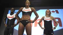 Olympians Justyn Warner (100m) Phylicia George (100m hurdles) and Sarah Wells (400m hurdles) model the track and field uniforms that Canadian athletes will be wearing at the London 2012 Games this summer. (Fred Lum/The Globe and Mail)